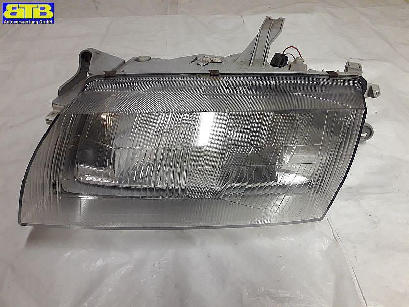 Hauptscheinwerfer links mit Lampenträger und Stellmotor für LWR / 1305235336MAZDA 323 P V (BA) 1.3 16V